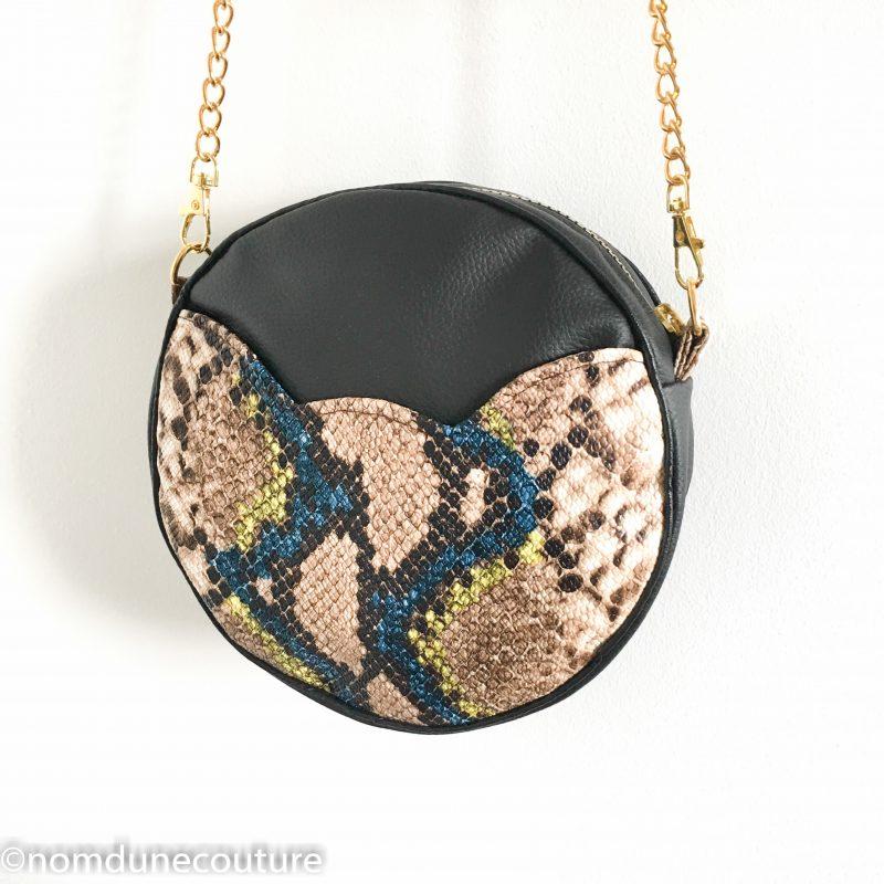 couture sac rond sun en simili cuir noir et python